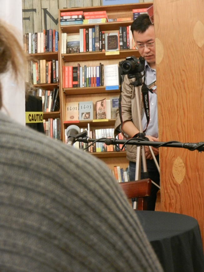 Photographer Capturing the People Watching a Documentary of a Poetry Reading