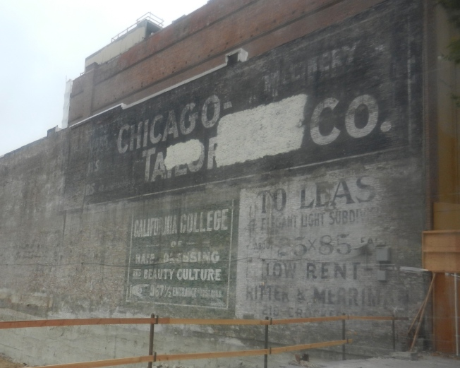 Old Advertising Exposed for the First Time in Decades on Market Street