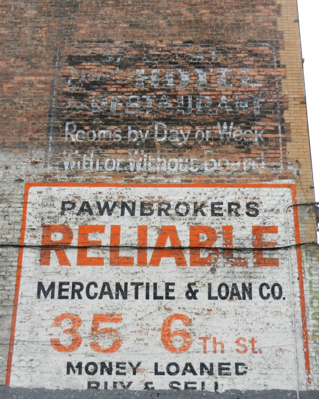 Old Advertising Overlooking Parking Lot
