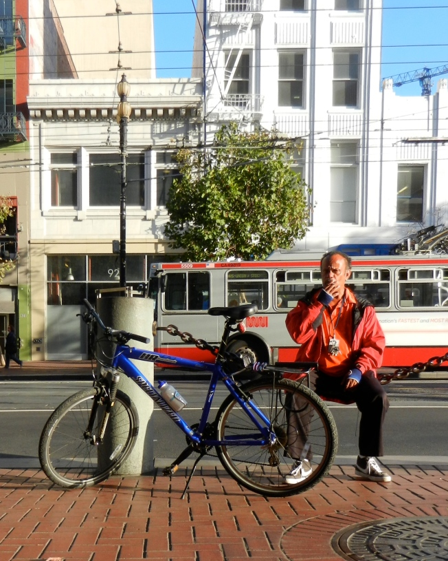 Bike Messenger Relaxing at the End of the Work Day, Market Street, San Francisco, California 10 October 2013