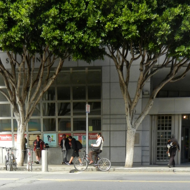Bicyclist in Front of the Library, Civic Center, 27 Feb  2014