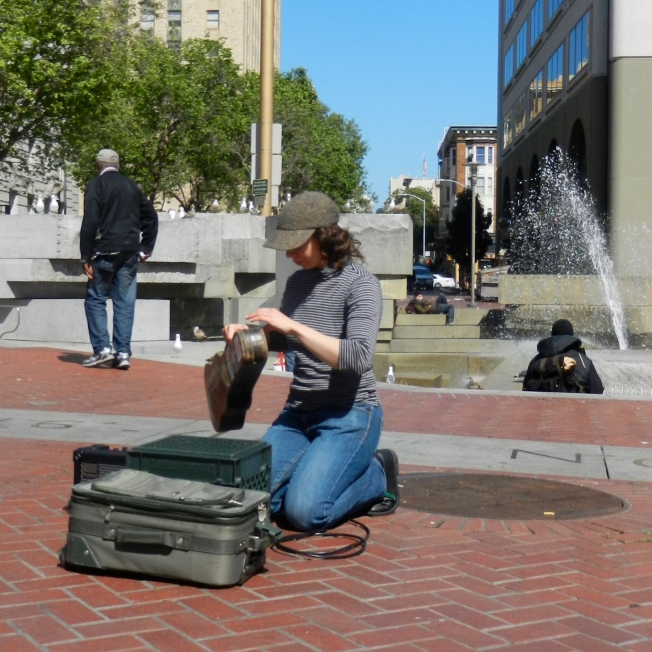Busker Packing Up After Performance, Civic Center Farmers Market, San Francisco