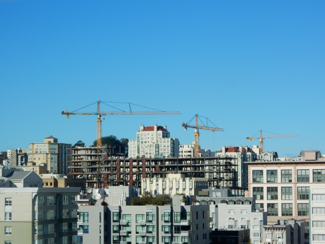 Construction Cranes on Van Ness as Seen from SFPUC Headquarters, 25 November 2015.